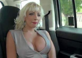 THis white haired elegnat milf is a heartbreaker. White haired flirtatious woman with huge boobs goes topless in front of lucky MILF Hunter. He loves her perfectly shaped boobs