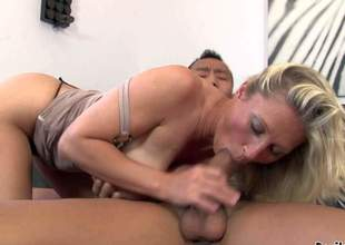 Devon Lee is a sex starved busty blonde MILF. Oriental guys receives naked and hawt mature blonde in mini dress pulls out her gigantic tits. She sucks his exotic cock like theres no tomorrow