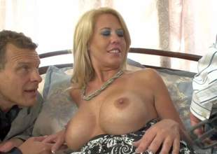 Grace Evangeline is a horny big titted mature blonde that gets double used. She has sex with her middle-aged lover and his son. Busty mom gets her mouth fucked and her snatch eaten out at the same time