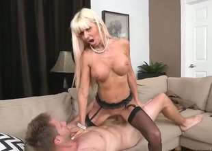 This long haired mature blonde with slim figure and huge boobs is a fuck hungry breathtaker. MILF in stockings shows off her killer pointer sisters as she rides on top of cock in the sitting room.
