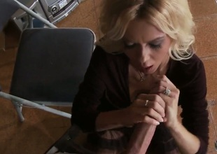 Dressed blonde milf Barbi Sinclair is playing with heavy huge piece of meat of Keiran Lee. She stands on knees sucking and stroking his big throbbing penis so well.