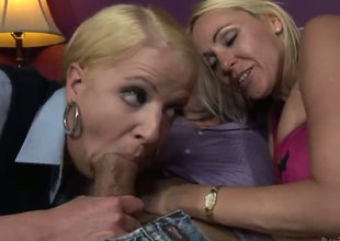 Anita Blue is one horny MILF. Watch this blonde cougar teach her daughter Raquel Sieb the art of sucking cock. The mommy and daughter enjoy a lucky mans erect pecker in this threesome.