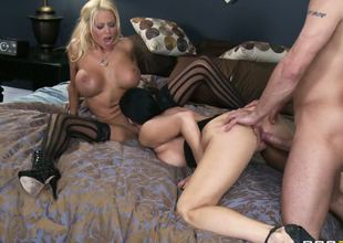 Mr. Pete gets to nail Vanilla Deville Nikita Von James, two sexual babes with huge wobblers and a crazy sex drive. The girls make him fuck them until theres no strength left in him...