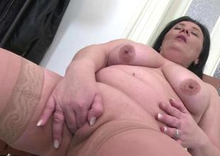 Chubby brunette hair mature toying her pussy