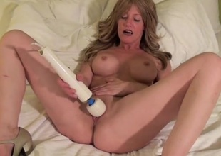 Milf in a hotel bed getting off with her Magic Wand