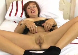 Old slut with a hand down her fishnet pantyhose
