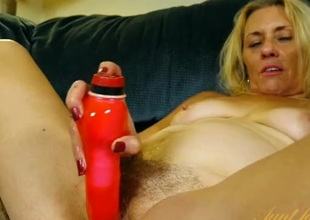 Brushing her pubic hair and fucking a toy