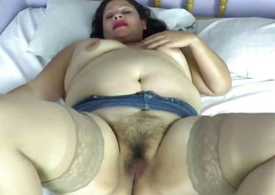 Fat latina mature undressing and widening legs