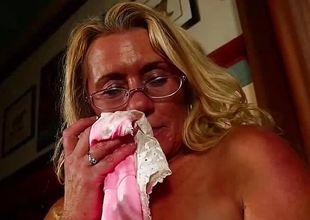 Mature amateur rubs her warm slit