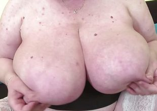 Granny playing with her tits