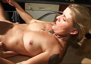 On a wooden table copulates blonde
