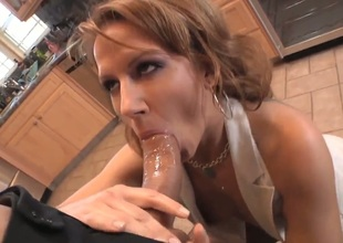 Hot mom Inari Vachs decides to show her new boyfriend that maturity and experience is a lot better that amateur, doing a nice old-fashioned blowjob for Roman Nomar in the kitchen