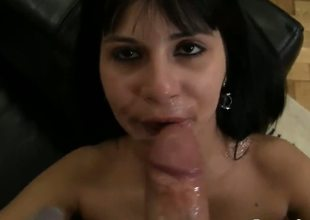 Slutty darksome haired and sexy honey Naomi A sucks and licks Rocco Siffredis dick on the sofa and gets cumsprayed all over her face after doing the job right