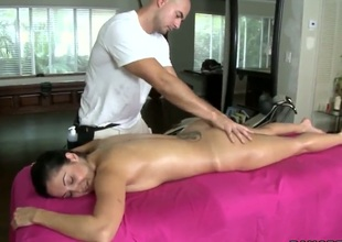 Busty Ava Addams gulps masseurs dick