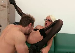 The sassy blonde milf Holly Price is absolutely seducing and turning on wearing nothing but black stockings on the busty body that receives served up by the rock hard stick
