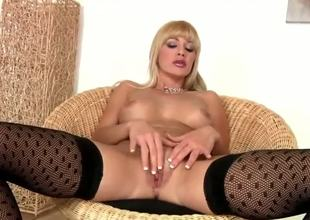 Natalli DAngelo looks great in those black stockings and matching heels. And I have to admit, shes got some moves on her, too. The kind only a MILF can possess. So hot.