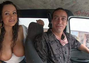 Lisa Ann is an experienced nice-looking porn diva. This Bang Bus update is all about lovelye MILF Lisa Ann and her dick-rising huge boobs. She displays her massive bra buddies with smile on her face