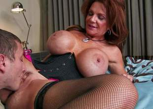 Deauxma is a gorgeous mature woman with fantastic massive tits. Slutty woman in black stockings exposes her killer melons as she gets her many times used snatch banged by younger dude