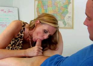 Julia Ann is one on one with one of her students after class... to sucks his cock! Juicy mature lady enjoys his sausage in her mouth and then widens her legs on a desk to let him take up with the tongue her snatch