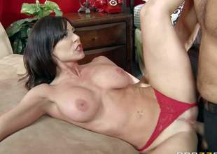 Kendra Lust is a gorgeous MILF with biggest boobs and tight pussy. She spreads her lengthy legs invitingly and pulls her red panties side. Man gives her snatch a lick and makes his rod disappear in her vagina