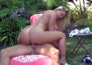 Cheating bootylicious blonde milf Devon Lee with big firm knockers in high heels only seduces Marcus London and rides on his stiff pecker in backyard like there is no tomorrow