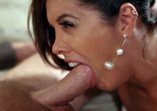 Stunning milf Franceska Le with big fake tits and delicious ass in awesome lingerie and high heels seduces Mark Wood and sucks his rock hard rod like there's no tomorrow
