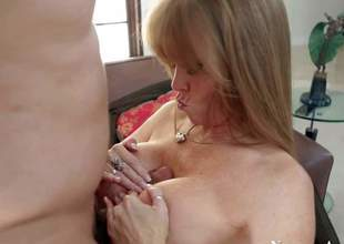 Gorgeous and hot busty milf Darla Crane enjoys in sweet her man Anthony Rosano after hes came home from work and gives him a hot titjob on her knees