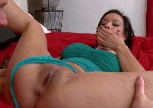 Dark haired and arousing brunette milf enjoys in getting picked up by a hot and sexy dude and receives her shaved taco licked by him on the bed in his apartment