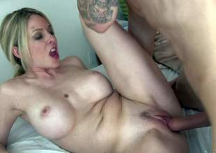 Fair-haired hot woman Angela Attison is a MILF with huge boobs and neat soaked pussy. Stacked golden-haired parts her legs and gets her snatch drilled silly by tattooed juvenile guy. That babe fucks the shit without MILF