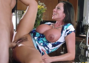 Elegant super hot MILF Ariella Ferrera with huge tits seduces her daughters boyfriend to satisfy her raunchy desires. Busty mom acquires her hot bush heavily fucked in the kitchen!