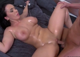 Oiled up MILF Sandra shows off her nice body as she gets her giant tits and totally shaved pussy banged good and hard in the comfort of the bedroom. This well endowed woman is a sexy thing!