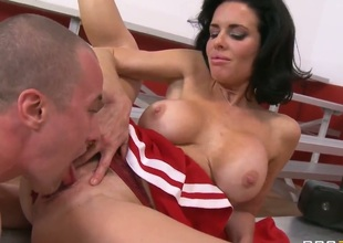 Attractive black haired milf Veronica Avluv with big fake tits and smoking hot firm gazoo in red cheerleader uniform gets licked shaved wet crack by Jessy Jones in close up.