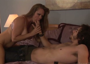 Experienced and cheating brunette cougar Dyanna Lauren with dark make up and biggest firm tits seduces young Xander Corvus and sucks his cock like crazy while her hubby is at work.