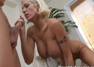 Appetizing milf pornstar Kasey Grant with a large fake tits wants some youthful and hard dick. This playful blonde seduces the attractive pornstar Seth Gamble and sucks his cock.