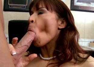 Seductive brunette pornstar Devon Michaels gets tempted by the Johnny Sins. This prepossessing milf with a large and tasty tits gets kissed and starts to sucks her partners cock.