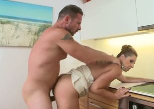 Daria Glower proves that a womans place is in the kitchen! David Perry makes the slutty mom bend over the kitchen counter so he could bang that soft round ass!