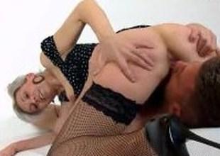 Sexy legs mature amateur lady Beate facesitting a boy