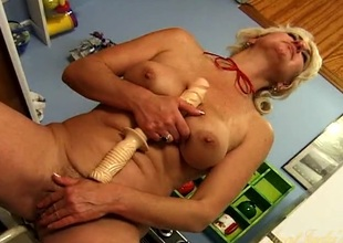Horny naked housewife fucking her cunt with a dildo