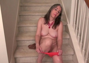 American milf Eva Griffin fingers her nyloned juicy pussy