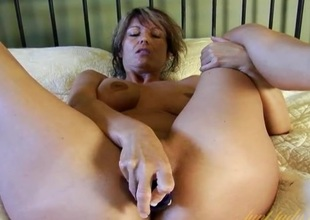 Vibrated milf pussy pleasured by a glass dildo