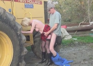 Old lady in a slutty skirt fucked on the farm