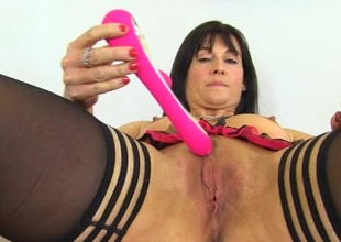 Classy milf slides a pink toy into her perfect bawdy cleft
