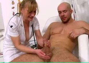 Lubed handjob from a talented mature nurse