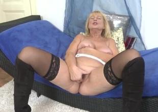 Granny slut in stockings fingers her hot box