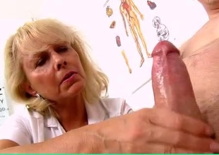 Mature nurse cutie jerks off a patient
