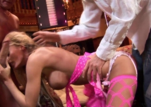 Saucy blonde Stacey can handle three studs by the fireplace