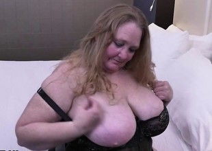 Fully shaved fat mature lady toying her cunt