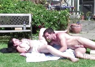 Mature lady having sex with a stud in the garden
