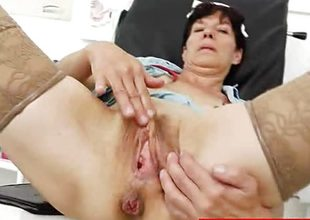 Mature nurse toys her soaked pussy