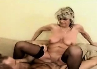 60yo blonde granny in stockings is pumped deep by a stud
